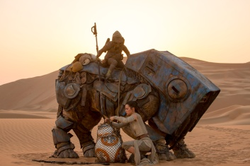 Star Wars: The Force Awakens..L to R: BB-8 w/ Rey (Daisy Ridley)..Ph: David James..©Lucasfilm 2015